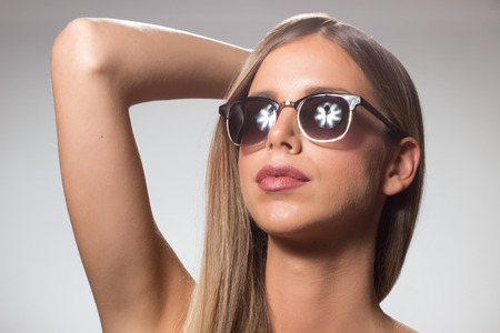 arm up: Young woman beauty sunglasses head arm up raised