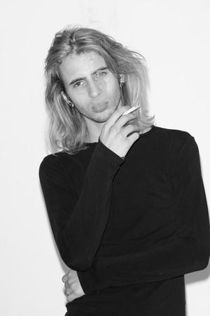 snapshots: young man fashion model snapshots black and white, smoking cigarette