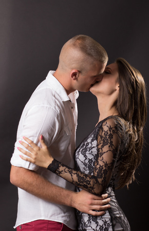20 years old: Young couple 20 years old kissing boy girl man woman black background