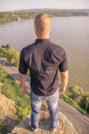 elevated: back rear view, freedom man high above elevated view