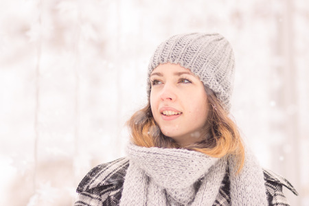 young adult woman, face, head close up, winter hat scarf