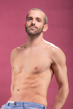 upper body: one young adult man, upper body, chest abs arms posing, pink background