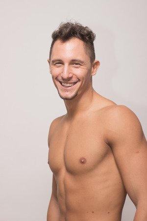 one adult young man, 25 years old, upper body, side view, model snapshot, candid smiling Stock Photo