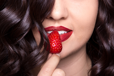young woman skin lips hair closeup srawberry beauty healty, red lipstick, unrecognizable person, open mouth