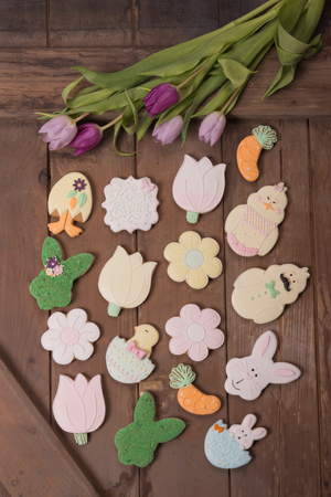 flay lay, many multiple gingerbread cookies, wood, rabbit bunny flowers shapes, painted Stock Photo