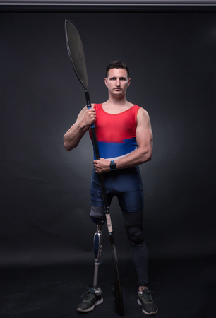 one young adult man only, canoe kayak paddle, athlete sportsman, prosthetic leg, disabled