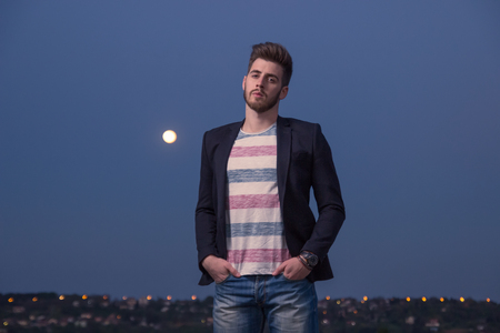 only adult: portrait, one young adult man only, smart casual clothes, Moon sky night