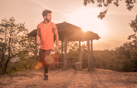 one young man, running, runner, sport clothes, outdoors sunny day Sun, recreation adventure Stock Photo