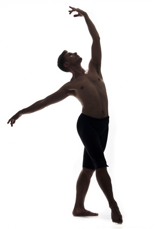 one young man, shirtless topless, ballet dancer, studio shot, white background isolated. full lenght shot, arms hand raised up, standing posing, looking up. Stock fotó