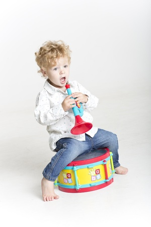 Toddler playing with toy musical instruments photo