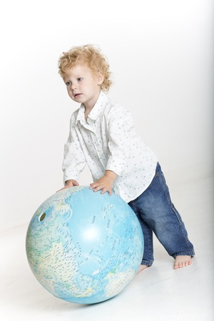 carpe diem: Young boy is holding the world in his hands Stock Photo