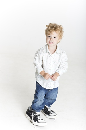 children s feet: Small boy is trying on big shoes Stock Photo