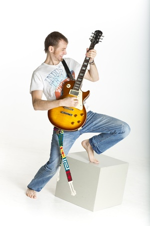 Man is rocking on electric guitar photo