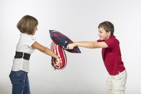 brother sister fight: Pillow fight Stock Photo