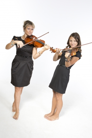 duet: Mother and daughter violin duet Stock Photo