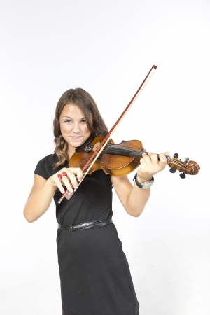 Teenager is playing on violin Stock Photo