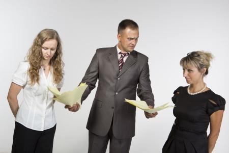 Boss criticizes his employees photo