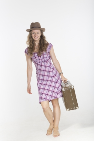 antique suitcase: Young woman with antique suitcase Stock Photo