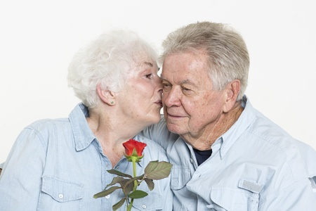 65 70 years: Senior man presents his wife with a flower