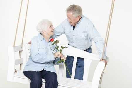 70 75: Senior man presents his wife with a flower