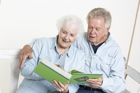Senior couple looks at picture album Stock Photo - 22142454
