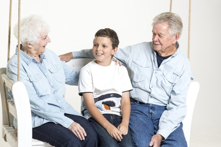 70 75: Grandson talks with his grandparents Stock Photo