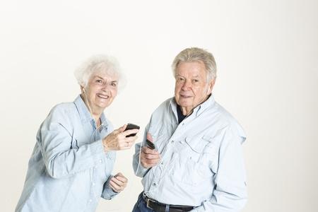 Senior couple is dancing to music in earphones photo