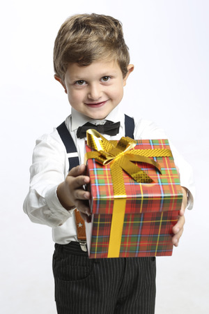 anticipate: Boy gives a Christmas gift