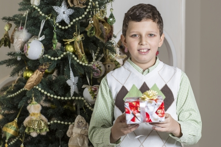 accepts: Boy with Christmas gift Stock Photo