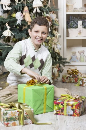 accepts: Boy opens Christmas gift