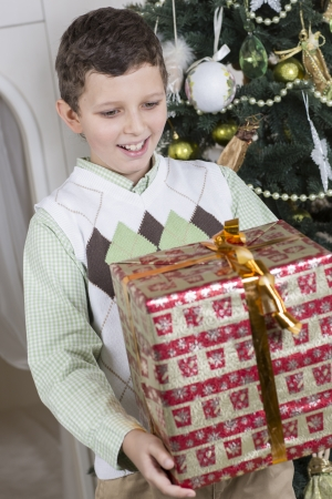 Happy boy with big Christmas gift photo