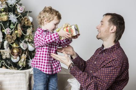 Son gives his father a Christmas gift photo