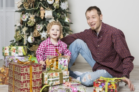 Father gives his son Christmas gift photo