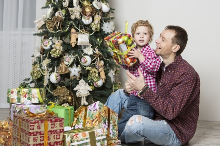 Father gives his son Christmas gift