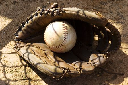 The Glove and the Ball at the Baseball field photo