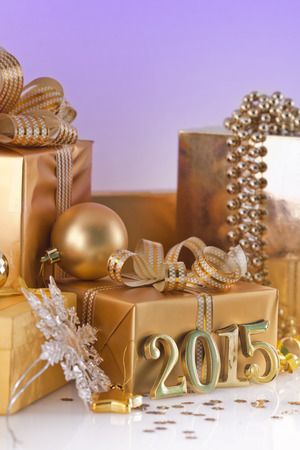 new year eve beads: Christmas decorations, gifts and gold figures Stock Photo