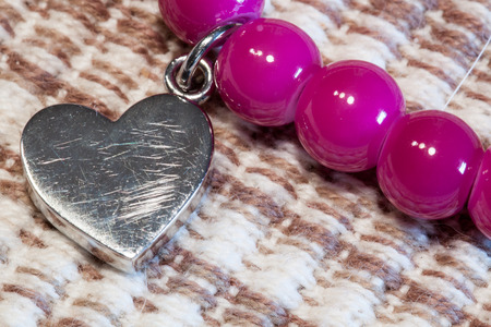 wounded heart: wounded heart .. silver heart bracelet with pink pearls on