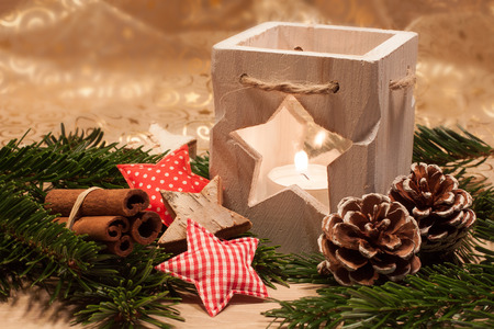 tealight: Christmas table decoration - wooden tealight with Christmas decoration Stock Photo