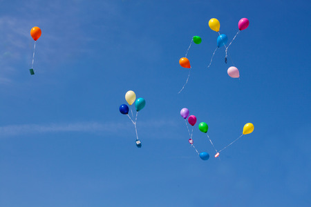 ascend: Colorful balloons ascend in the sky Stock Photo