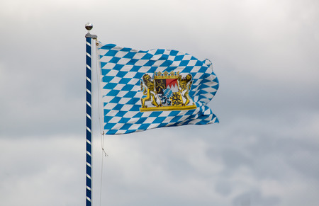 unofficial: Unofficial Flag of Bavaria with national emblem Stock Photo