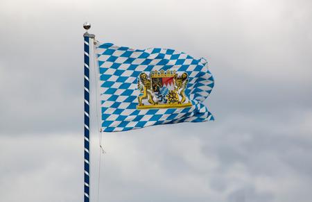 national  emblem: Unofficial Flag of Bavaria with national emblem Stock Photo