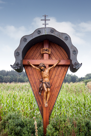 wayside: A wooden wayside cross - wayside cross in Rehling and Aindling in Bavaria - Germany Stock Photo
