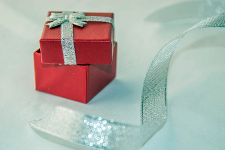 Valentines day! Red box for a gift with silver ribbon, isolated on a white background.