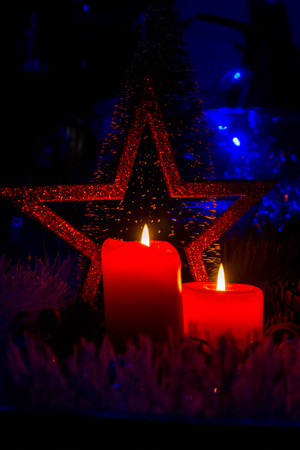 It's a holiday. Red candles on a dark background, an inevitable detail when the holidays are on.