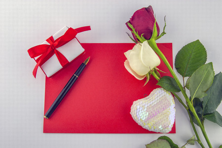 International Women's Day, March 8. Red white cards with pen and decorative items, roses, hearts, chocolates, gift box on a white background. Stock Photo
