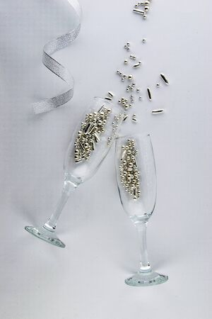 It's party time! Two champagne glasses with shimmering decorations.
