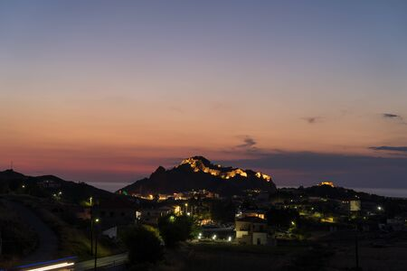 City lights and scenic colorful sky above Byzantine Castle in Myrina, Greece Banco de Imagens