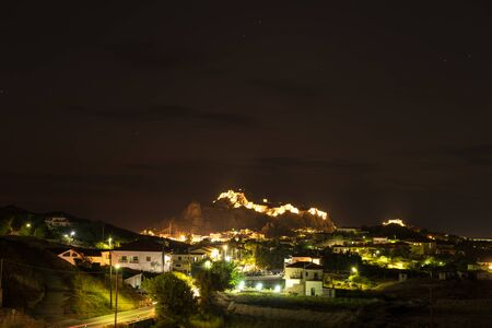 Night photo of the lighs above Byzantine Castle in Myrina, Greece Banco de Imagens