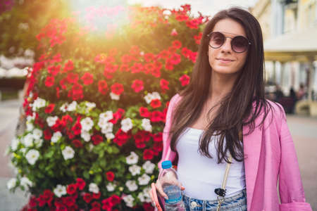 Women in font of flowers,tourist adventure in Plovdiv european capital of culture