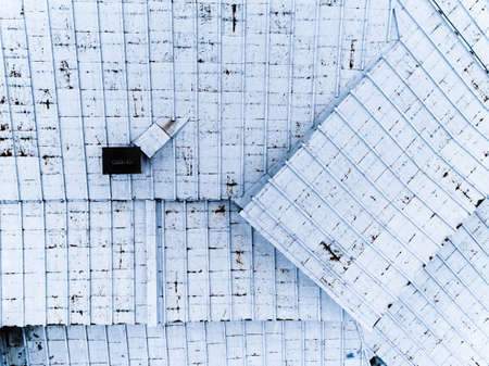 Top view of building metal roof construction. Diagonals Abstract background stock photo Banco de Imagens